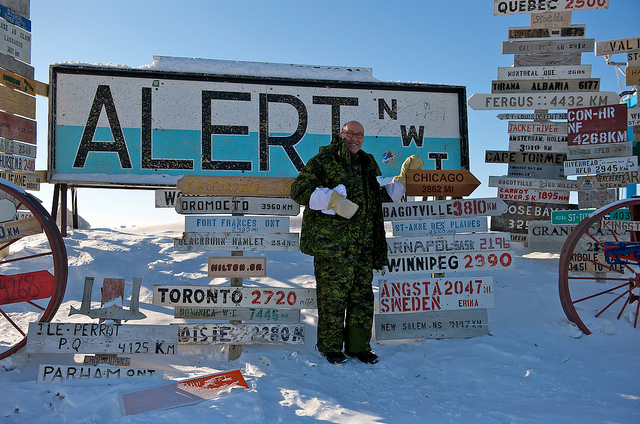 United States Ambassador Jacobson with newly installed Chicago road sign at Alert, Nunavut